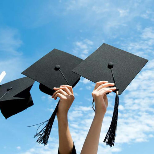 Students Holding Graduation Caps